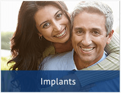 smiling couple whith the woman's arms around the man and a text bar at the bottom that says 'implants'