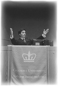 black and white photo of Dr. Jureidini speaking at a podium