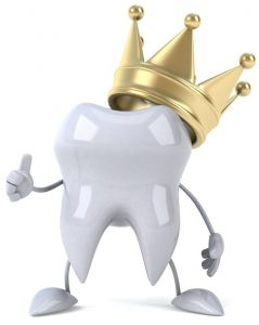cartoon tooth wearing a crown and giving a thumbs up