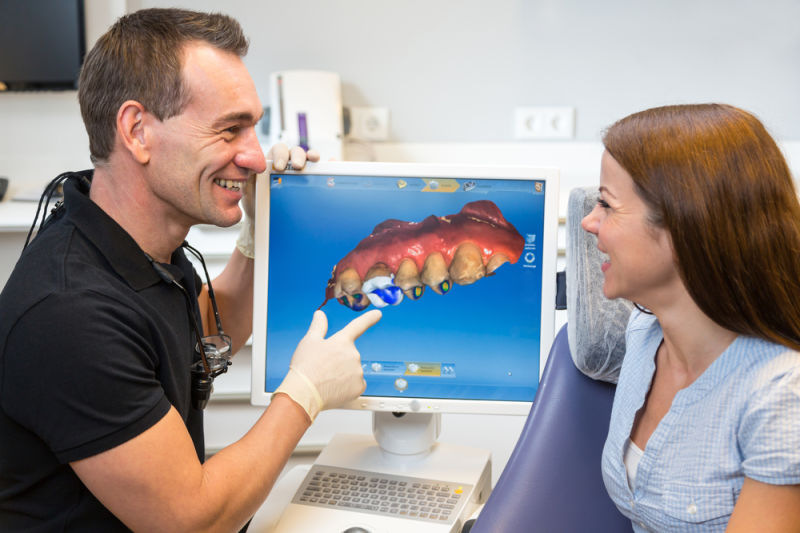 dentist explaining cerec same day crowns